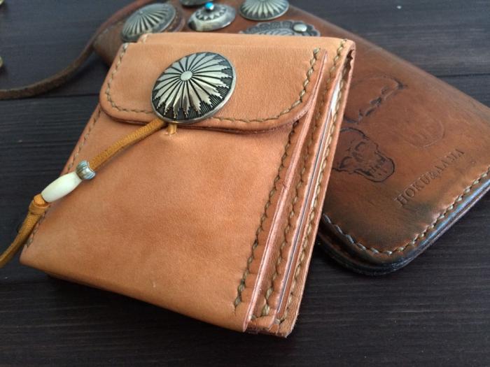 新しく二つ折りの財布作りました。っでエイジング...は